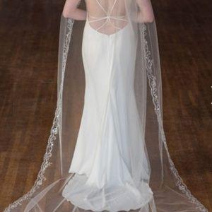 New/ never worn Wedding dress and veil